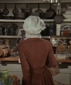 "Caroline Ingalls walks into the Oleson's store in ""Little House on the Prairie"""