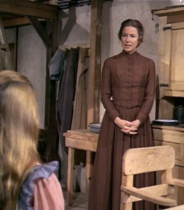 Ma Ingalls talks with Mary in their Little House on the Prairie
