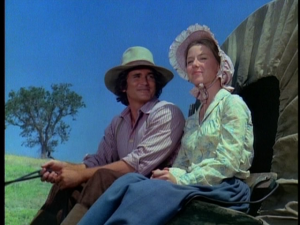 "Charles and Caroline Ingalls in covered wagon in ""Little House on the Prairie"""