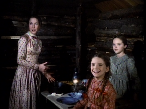 The Ingalls Ladies stare at Mr. Edwards who arrives covered in ice and nearly frozen.