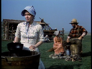 """Ma"" Caroline Ingalls' flowered blouse and sunbonnet washing dishes"