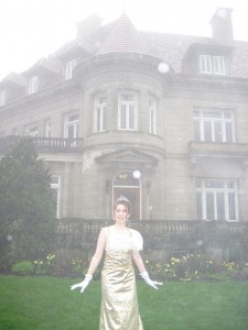 Gold lame party dress in front of castle
