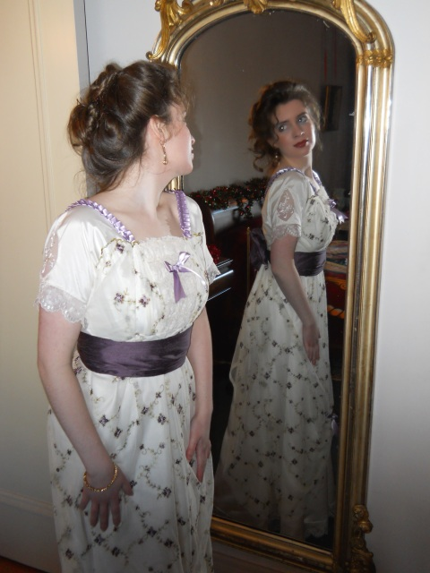 lady-looking-in-a-victorian-mirror-with-edwardian-dress