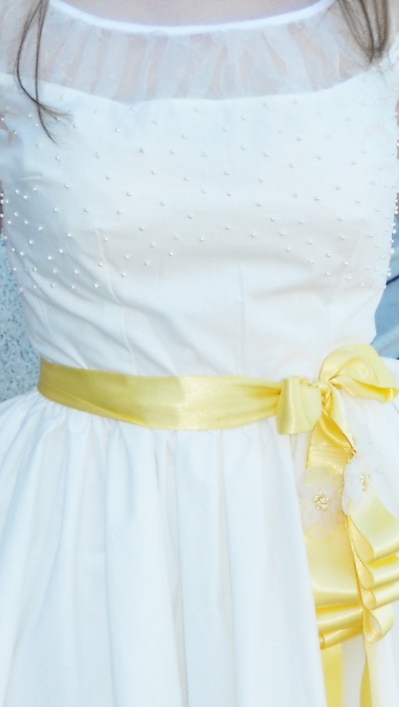 white-dress-yellow-sash